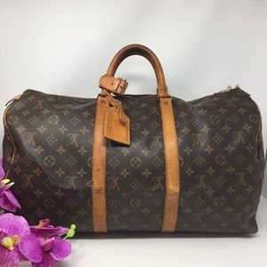 Preowned Authentic Louis Vuitton Keeppall 50